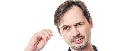 Man using q-tip in ear